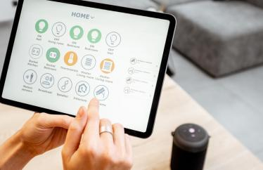 Someone using a smart home tablet
